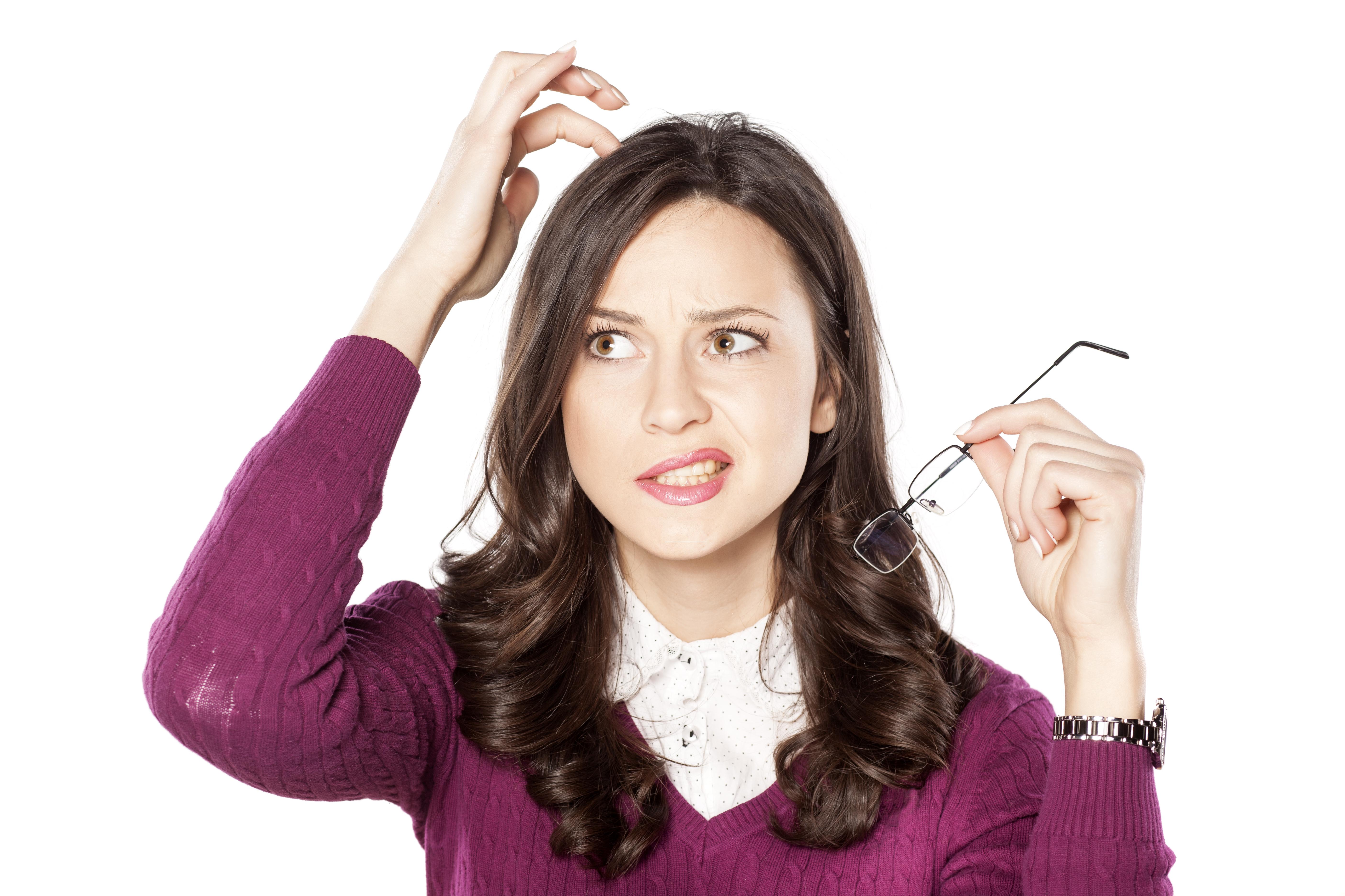 AdobeStock_78581941 - business woman scratching head